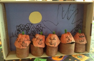 All the grands helped make the diorama. Tigger drew pumpkin faces and the scary background. Tahoe glued the background to the shoebox lid.