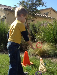 "When studying the letter R, Kona had to say a word with the ""r"" sound before he could toss a ring over a cone."