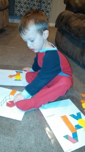 Tahoe was eager to use his pattern blocks on pre-made mats to make Nativity scenes.