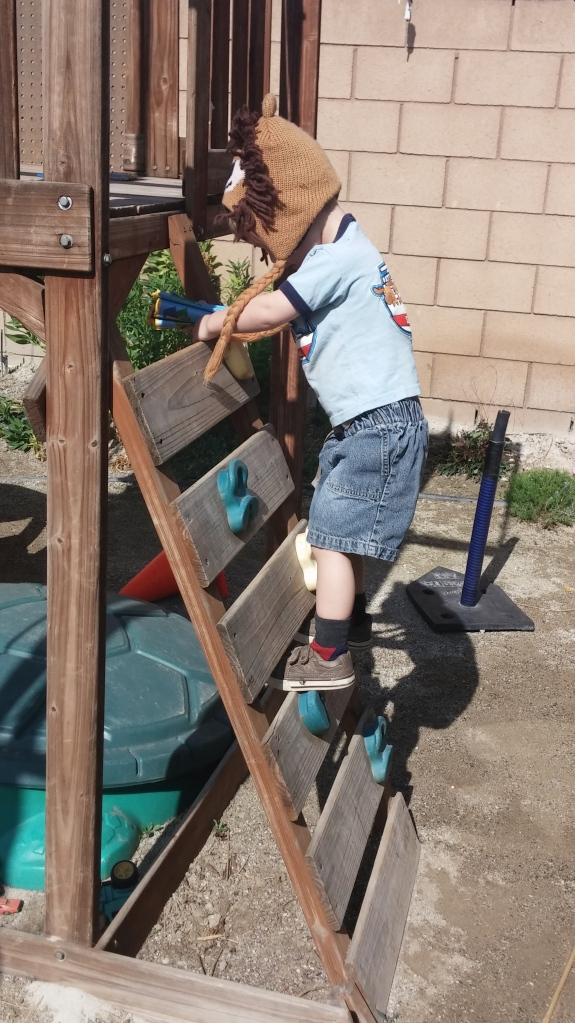 "Tahoe climbs ladders a lot, but now as he climbs I help him hear the ""L"" sound in ladder. (Yes, my grands love wearing silly hats when they play.)"