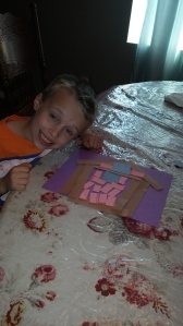 """I love to see how each grandson uses their own creativity in """"constructing"""" a building out of construction paper. Tigger is very proud of his project."""