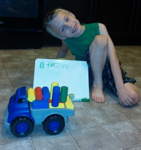 After adding the six blocks to his toy truck, Tigger finished the equation.