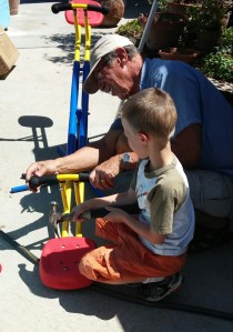 Grandpa Jim and Tigger work together to put together a seesaw for our backyard.