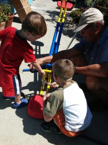 Both Tahoe and his older brother lent Grandpa Jim a helping hand to put together their new seesaw.