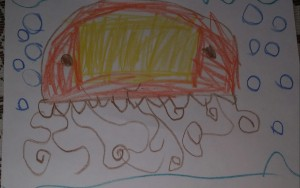 Tigger (7) decided to color his sea jelly after he finished drawing the outline.