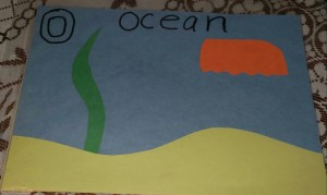 I created a play dough mat using construction paper. (I told the grands that the mat showed sand, seaweed and a sea jelly.)