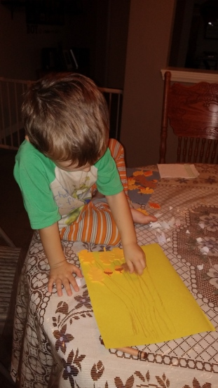 Tahoe, age 3, drew brown crayon lines to make his tree and then added stick-on leaves and acorns.