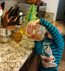 Then I had my grandson pour the apple cider to the 2 cup line.