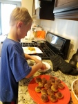 Tigger loved adding the toppings to the baked muffins.