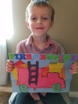 Finally Tahoe glued some foam letters onto his completed project. He is super proud of it!