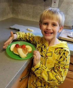 Kona enjoyed adding the fruit to the pancake to make it look like an elephant.