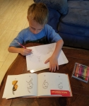 Tigger preferred using a book with step by step instructions to draw some Thanksgiving designs.