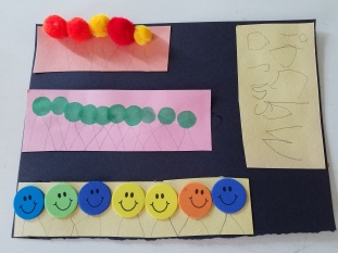 After making the inchworms using three types of materials, they were combined and glued on black construction paper.